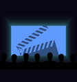 people in the cinema watch a movie clapperboard vector image