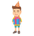 caucasian boy in birthday cap holding gift box vector image