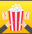 two human businessman hands holding big popcorn vector image