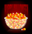 happy halloween bowl and candy corn sweets on vector image vector image