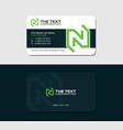 dark business card with green letter n vector image vector image
