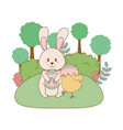 little rabbit and chick with egg painted in the vector image vector image