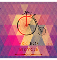 Retro bicycle on a grungy background of triangles