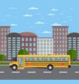 yellow school bus on road in urban landscape vector image vector image