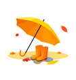 orange umbrella and rubber boots on puddle after vector image