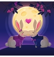 two kissing rabbits on moon background vector image