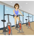 young woman doing indoor biking exercise at gym vector image