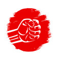 clenched fist on red brush stroke circle hand vector image vector image
