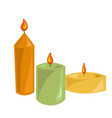 lighted candles made of wax with small flames vector image