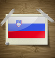 Flags Slovenia at frame on wooden texture vector image vector image