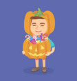 boy in a halloween costume with pumpkin basket vector image