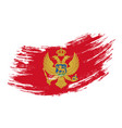 montenegrian flag grunge brush background vector image vector image