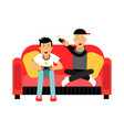 two young male friend sitting on sofa and playing vector image vector image