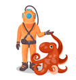 deep sea diver in pressure suit holds sea devil vector image vector image