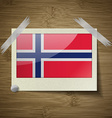 Flags Norway at frame on wooden texture vector image