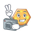 photographer hexagon mascot cartoon style vector image