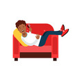 black young man lying on a red armchair and vector image