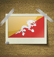 Flags of Bhutan at frame on a brick background vector image vector image