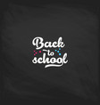 welcome back to school label on a chalkboard vector image vector image