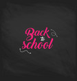 welcome back to school label on a chalkboard vector image