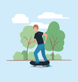 young man in skateboard on the park vector image