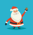 happy cartoon santa claus holding a gift on a blue vector image
