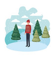 young man with winter clothes and winter pine vector image vector image