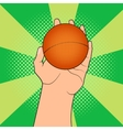 Game ball in hand vector image vector image