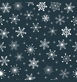 seamless pattern with snowflakes and stars vector image