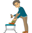 man cleans his shoes vector image vector image