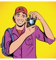 Photographer with camera comics icon vector image