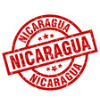 nicaragua red round grunge stamp vector image vector image