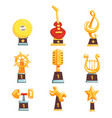 golden trophy cups awards and achievements set of vector image vector image