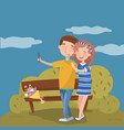 happy young couple making selfie in the park vector image