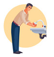 man washes his hands under running water vector image vector image