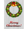 Christmas wreath on a grey wooden background vector image vector image