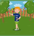 cute redhead boy making selfie photo in the garden vector image vector image