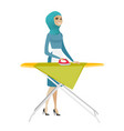 muslim maid ironing clothes on ironing board vector image