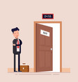 businessman or manager faces an open door waiting vector image