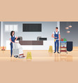 couple cleaners vacuum cleaner happy man woman vector image