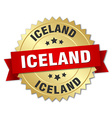 Iceland round golden badge with red ribbon vector image vector image