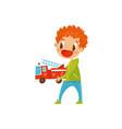 redhead little boy playing wirh fire truck cute vector image