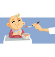 cute little babeing fed using spoon vector image vector image