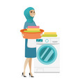 muslim housewife using washing machine at laundry vector image vector image