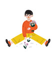 boy picking flowers kids spring or summer outdoor vector image vector image