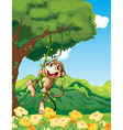 A monkey clinging at the vine plant vector image