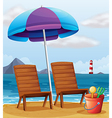 A beach with an umbrella and chairs vector | Price: 1 Credit (USD $1)
