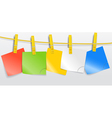 Blank color paper sheets on rope