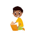 cute boy sitting on the floor and reading a book vector image vector image
