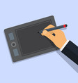 designer draws on graphic tablet by pen vector image